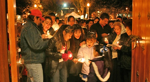 Visitors sing in the Posada