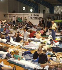 Tourists in a provisional shelter during a hurricane